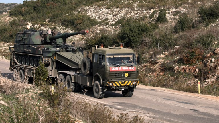 A Turkish army truck loaded with a self-propelled gun heads to the Syrian border near Yayladagi on Wednesday.