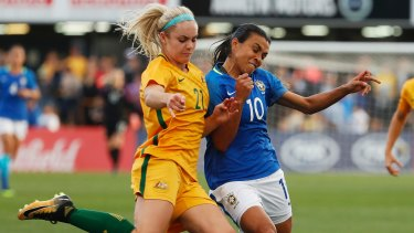 Australia's Ellie Carpenter fights for the ball against Brazil's Marta Vieira during their friendly last month.