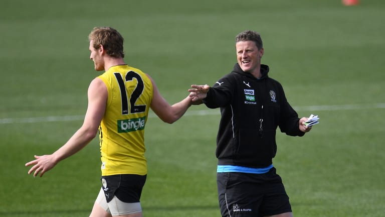 David Astbury shares a moment with coach Damien Hardwick at training on Tuesday.