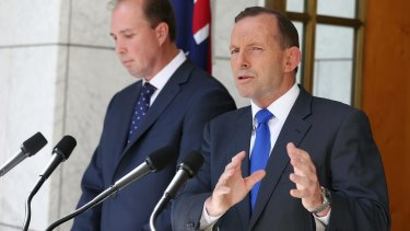 Prime Minister Tony Abbott, pictured with Health Minister Peter Dutton, has conceded the government's planned $7 GP fee will have little hope of passing the Senate.