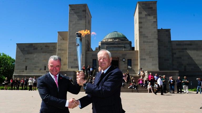 Dr Brendan Nelson Director of the Australian War Memorial and Alan Ferguson Chairman of Camp Gallipoli holding the RSL Anzac Flame.
