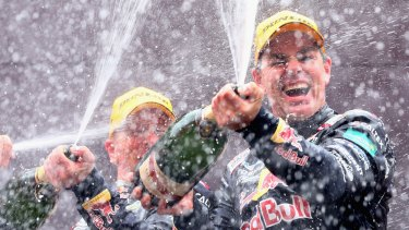 Craig Lowndes and Steven Richards celebrate on the podium after winning the Bathurst 1000.