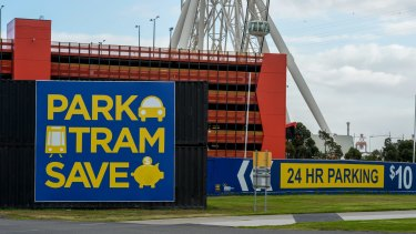 Signs advertising the Harbour Town Docklands carparks which encourage people to park and catch the free tram. Photo by Penny Stephens. The Age. 11TH MAY 2015