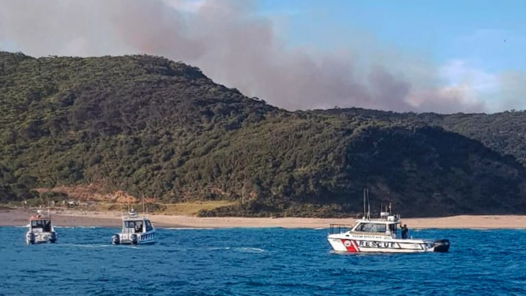 Boats off Garie Beach to evacuate people.
