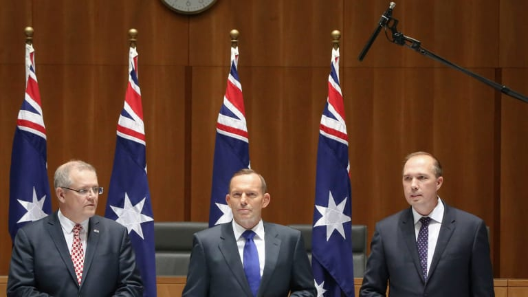A boom microphone picks up the private conversation of Scott Morrison, Tony Abbott and Peter Dutton last year.