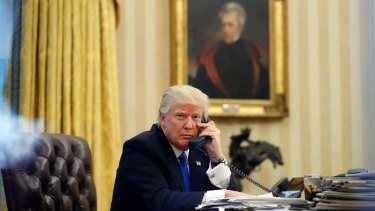 President Donald Trump speaks on the phone with Prime Minister of Australia Malcolm Turnbull in the Oval Office of the White House.