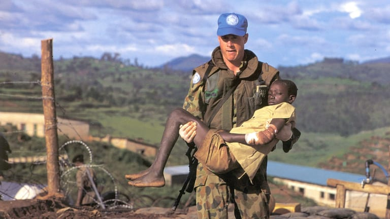 Gittoes' famous photo of an SAS trooper and massacre survivor in Rwanda.
