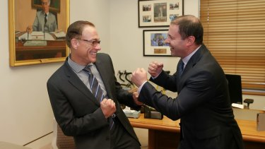 Minister for Environment and Energy Josh Frydenberg with Jean-Claude Van Damme in Parliament House  in Canberra on Thursday.