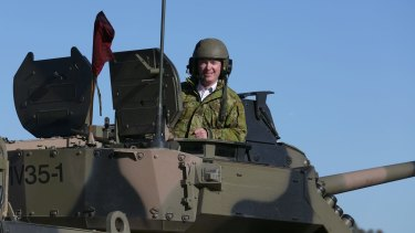 Defence Industry Minister Christopher Pyne, in the turret of Patria AMV35 at Puckapunyal Range, Victoria.