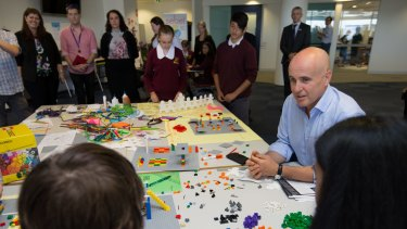 NSW Minister for Education, Adrian Piccoli, with students from Campbelltown Performing Arts School, in one of the collaborative learning spaces.