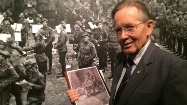 Ron Purssey holds the picture of his father Roy taken at Vignacourt in 1918. Photo: Natalie Bochenski