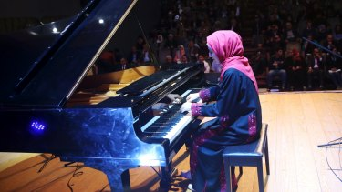 Palestinian pianist Yara Thabit plays the piano to a packed house.