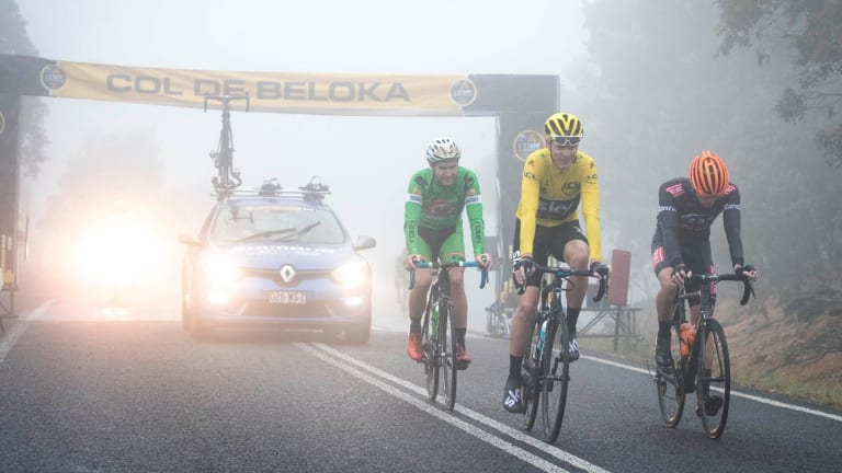 Tour de France champion Chris Froome, in yellow, at the top of the mountain stage at L'Etape.