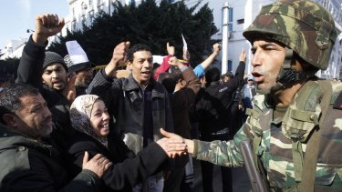 Protesters greet soldiers during a demonstration against former Tunisian President Zine El Abidine Ben Ali in 2011.