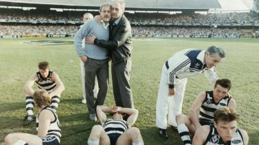 Malcolm Blight after the '89 grand final loss. with players including Couch (bottom right).
