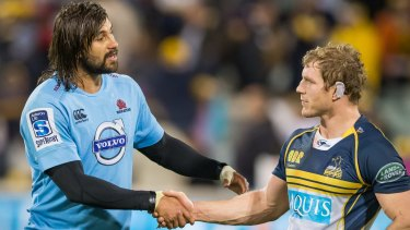Jacques Potgieter and David Pocock shake hands after the Waratahs beat the Brumbies.