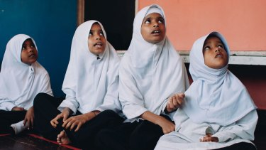 Rohingya girls join a basic mathematics class in a school run by an NGO in Penang, Malaysia.
