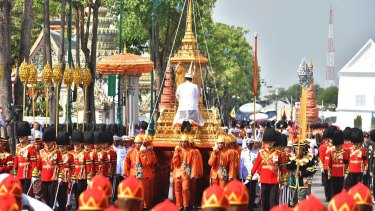 The ceremony began with the transfer of the remains of King Bhumibol Adulyadej to his spectacular golden crematorium on Thursday morning.