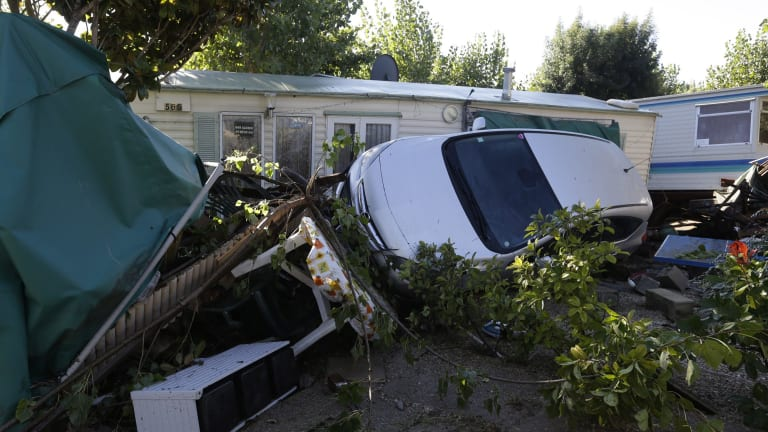 Debris and a damaged car are pictured in the campsite of Biot, near Cannes.