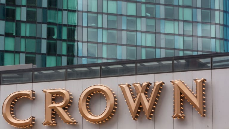 A Chinese Australian is suspected of money laundering after gambling $850 million at Crown Casino over eight years.