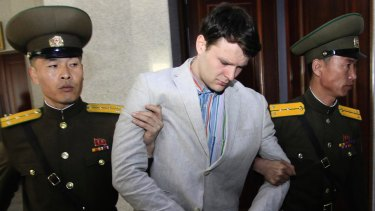Otto Warmbier, centre, is escorted at the Supreme Court in Pyongyang, North Korea in March 2016.