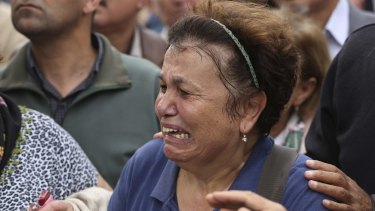 A protester is overcome with emotion at the Sunday rally in Ankara.