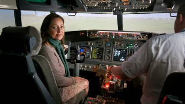 Mastering the fear: Eliza Strauss in a flight simulator with flight instructor Tom Dyke at Flight Experience.