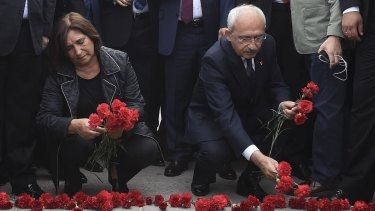 Kemal Kilicdaroglu, head of the opposition Republican People's Party, and his wife, Selvi, lay flowers at the site of Saturday's bombings in Ankara.
