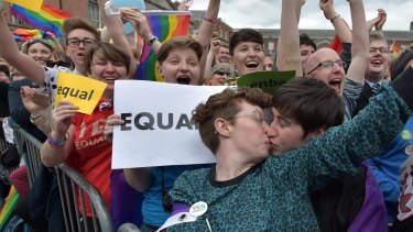 A couple kiss in Dublin Castle Square as the result of the May 2015 referendum is announced.