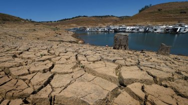 Dried mud and the remnants of a marina at the New Melones Lake reservoir.