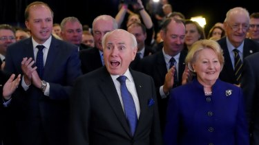Former prime minister John Howard, pictured with wife Janet, appeared to enjoy the launch more than Tony Abbott.