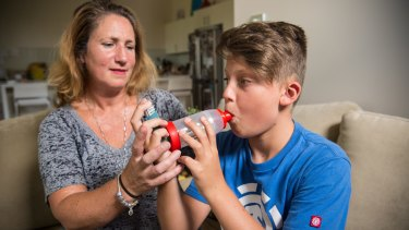 Finn Kovich with his mother, Nina, at their home in Killara. Both suffer from asthma.