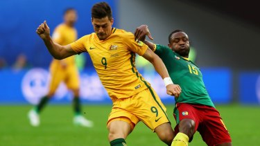 Tomi Juric and Sebastien Siani of Cameroon battle for possession during the FIFA Confederations Cup Group B match.