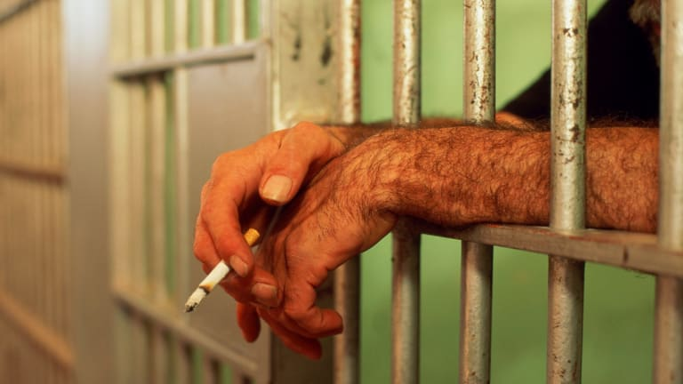 Despite smoking being banned inside WA's prison buildings, it is still allowed in outdoor areas.