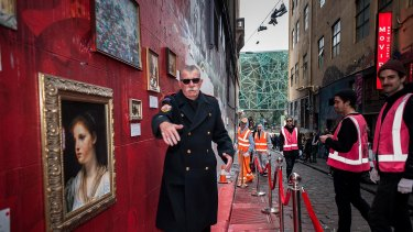 One of street artist Lush's 2015 publicity stunts included arts patron Andrew King posing as museum security in Hosier Lane.