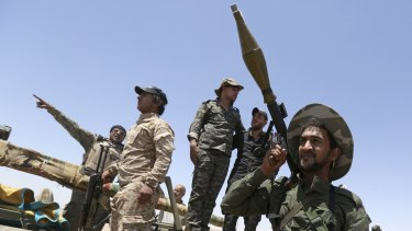 Fighters from the Shiite  Badr Brigades militia. Members of the group, closely linked to Iran,  accuse the US of providing Islamic State with weapons and rations.