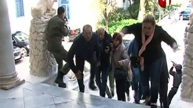 People escape from Tunis' Bardo Museum during an attack by two men armed with assault rifles.