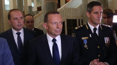 Immigration Minister Peter Dutton and Prime Minister Tony Abbott attend the swearing in ceremony of the inaugural Border Force commissioner Roman Quaedvlieg.