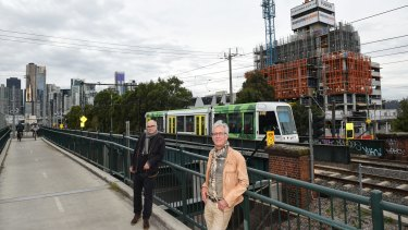 David Brand, left, and Richard Roberts fear the Fishermans Bend development will repeat Southbank's mistakes. The area's first tower, behind them, is now under construction.