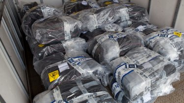 Authorities seized several black bags carrying packets of cocaine off the Elakha yacht.
