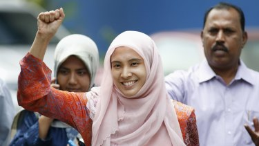 Nurul Izzah raises her fist as she is released on bail from a police station in Kuala Lumpur on Tuesday.