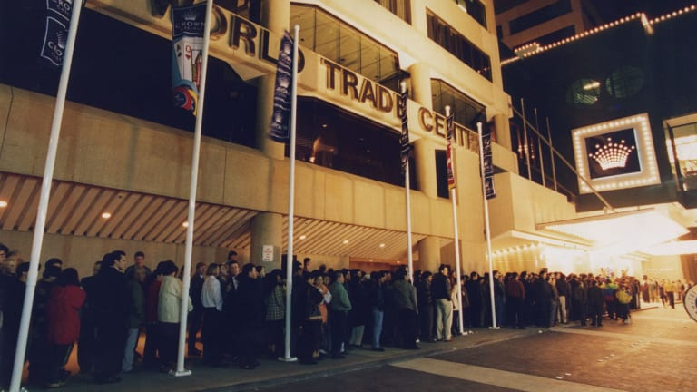 People queue to get into the temporary Crown Casino at the World Trade Centre.