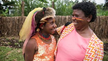 Doreen Pipiki, right, with her daughter Marianne-David at Kuluanda Primary School in Hela province, PNG.