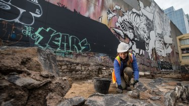 Sarah Myers at work on an archaeological dig at the site of the old Mistletoe Hotel in Melbourne.