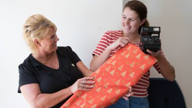 Kathryn Cameron with her daughter Rachael, is planning to give secondhand gifts this Christmas in Sydney. Rachael is holding a secondhand camera she once received.