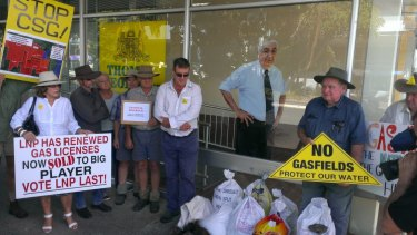 Protesters in Lismore dumping bags of cow manure outside Nationals MP Thomas George's electoral office.