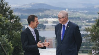 Territory and Municipal Services Minister Shane Rattenbury and National Capital Authority chief executive Malcolm Snow at the top of Mount Ainslie.