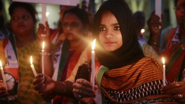 Activists hold lighted candles during a protest in Mumbai on December 21, 2015 against the release of a juvenile convicted of rape.