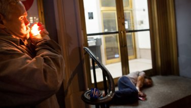 Charles Medina, lighting up at left, is a homeless man in New York who has used a synthetic drug known as K2.