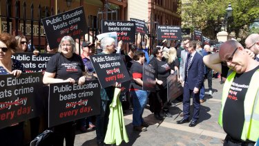 Unions across NSW are rallying against the Baird government's plans to privatise the work of prison teachers.
